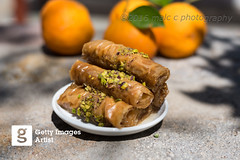 Baklava roll pistschio and honey (Malc ) Tags: food horizontal dessert greek photography greece honey snack foodanddrink filo baklava greekfood lifestyles greekculture colourimage sweetfood pistachionut