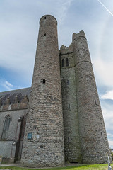 The original Round Tower at Lusk with its 'modern' companions! (swordscookie) Tags: church communitycentre graves monastery lusk gravestones roundtower stmaur fingal cofi normantower northcountydublin stmaccullin