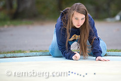 Girl Playing Marbles (Remsberg Photos) Tags: blue usa game fun maryland leisure alta setup marbles awards tradition activity cumberland compete