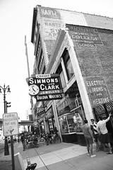 Simmons And Clark (peterkelly) Tags: bw usa building men brick sign wall digital us unitedstates watches michigan unitedstatesofamerica detroit patio northamerica conversation heating hartz jewelers businesscollege electricirons