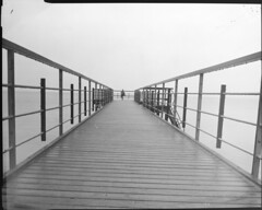 At the swimming pier (nicholas dunning) Tags: ocean camera travel bw white black film water analog river landscape denmark outdoors diy europe view large 4x5 hp5 format analogue ilford fujinon aarhus 135mm