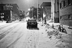 011/366 (local paparazzi (isthmusportrait.com)) Tags: street city portrait blackandwhite bw white black cold blancoynegro car night contrast outdoors eos 50mm prime pod aperture raw pavement f14 grain snowstorm tracks footprints covered chilly usm noise snowfall tread blizzard ef chilled subzero 2016 canonraw cr2 isthmus iso6400 50mmf14usm 366project photoshopelements7 canon5dmarkii localpaparazzi redskyrocketman lopaps isthmusportrait