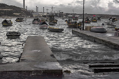 Unsettled (kurjuz) Tags: sea clouds boats waves malta desaturated ripples rough chimneys greys marsaxlokk