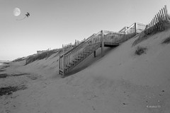 Brian_OBX 168a LG BW_062815_2D (starg82343) Tags: vacation blackandwhite bw moon white kite beach grass stairs fence outside outdoors evening nc sand dunes sandy hill steps northcarolina monotone stairway coastline grayscale 2d picturesque outerbanks lunar sanddunes eastcoast sandfence brianwallace sanddunefence