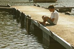 boy fishing in the river (pruden2009) Tags: sea summer vacation lake playing love boys field cane kids river outdoors happy one fishing dock pond warm peace affection action young adorable lifestyle happiness entertainment rod casual leisure activity relaxation intimate caucasian negativeconcepts boyfishing fishingintheriver