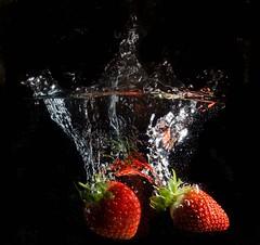 Strawberry splash6 (garlick.rachel) Tags: abstract black colour macro water fruit fun strawberry dof strawberries splash watersplash
