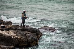Pesca. (Alessandro Photo - ALPH) Tags: mare uomo pietre da lungomare pesca burrasca spiaggia bari canna vento scogli schiuma litorale palese