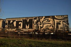 KEM YETI (TheGraffitiHunters) Tags: street red white black art car train graffiti big colorful paint gray tracks spray whole covered boxcar yeti freight kem benched benching