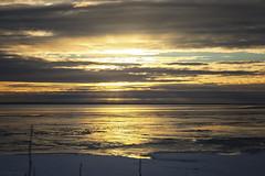 My Last Sunset (cheyzan) Tags: winter light sea sky sun snow reflection ice nature water alaska clouds canon river landscape eos coast mar agua view mark iii horizon nubes land 5d rays crepusculo oceano ecosystem