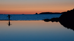 Saint-Malo (Corinne Queme) Tags: sunset mer france reflection water silhouette rock landscape brittany eau bretagne calm reflet paysage rocher saintmalo calme coucherdesoleil
