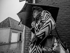 rain (Peter M. Meijer) Tags: street people urban bw woman man holland netherlands monochrome strada strasse friesland straat 2016 frisian olympus1240mm olympusomde1