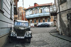 Tbilisi Alleyway (Weekend Wayfarers) Tags: street travel urban streets travelling cars car architecture georgia outside outdoors alley travels classiccar jeep jeeps exploring travellers oldbuildings travellings adventure explore alleyway traveling streetscape oldbuilding travelers classiccars tbilisi travelblog streetscapes alleys alleyways tiflis travelphotography  travelphotographer travelblogs travelblogger travelings travelbloggers travelphotographers travelblogging weekendwayfarers