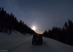 Safe return (gmacfly) Tags: travel winter moon snow canada mountains night zeiss stars fun rockies drive nikon glow jeep snowy carl roads slippery myrrs d810a geraldmacuaphotography