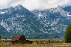Mormon Row (Marc Haegeman Photography) Tags: usa cloud mountain mountains barn landscape nikon outdoor scenic americana wyoming grandtetons jacksonhole mormons americanhistory grandtetonnationalpark mormonrow antelopeflats johnmoultonbarn nikon80400mmf4556 tamoultonbarn nikond750