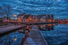 Haarlem blues (reinaroundtheglobe) Tags: city longexposure urban haarlem netherlands architecture clouds reflections river cityscape nederland historical bluehour noordholland