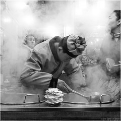Cooking up a Storm! (Chris Lue Shing) Tags: china street city cooking restaurant blackwhite shanghai candid smoke cook citylife spoon steam chef streetfood qibao qibaoancienttown shanghaishi fujixa1 chrislueshing fujifilmxc1650mmf3556ois