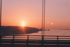 no time to crank the sun and dry our hair before we go. (mind over time) Tags: travel bridge sunset film vintage river warm lisboa lisbon sintra ponte pinksky elvy vscofilm