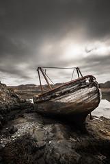 The Sailor's Grave (Neillwphoto) Tags: clouds island boat argyll atlantic anchorage shipwreck isle westernisles seil phuilladobhrain