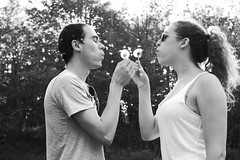 Dandelion Wishes (ii) (sarah-sari19) Tags: trees boy summer people blackandwhite woman man love nature girl sunglasses june outside couple wishes ponytail eyesclosed dandelions dandelionseeds dandelionwishes