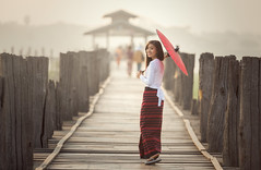 N13_5412 (Bugphai ;-)) Tags: wood travel bridge red people woman girl beautiful umbrella sunrise asian gold wooden asia warm burma traditional bein u myanmar burmese mandalay bagan unidentified