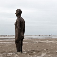 Knee deep (Hilary Causer) Tags: uk greatbritain sea england sky sculpture men beach weather standing march sand overcast coastal installation northeast greyday crosby dogwalking antonygormley dullday anotherplace