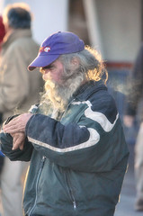 2016-01-03 (102) Laurel Park fan (JLeeFleenor) Tags: photos photography md marylandracing marylandhorseracing laurelpark people caps ballcaps beard grey gray cigarette smoker maryland