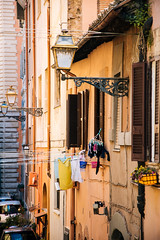 Drying clothes (lorenzoviolone) Tags: houses windows italy roma buildings reflex nikon streetphotography clothes flats wires streetphoto lamps dslr drying lazio dryingclothes fujiastia100f fav10 vsco d5200 nikkor18105mm nikond5200 vscofilm streetphotocolor walk:rome=april2016