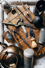 Old kitchen props (CreativePhotoTeam.com) Tags: wood old food brown mill home cooking kitchen cheese rural vintage table restaurant design countryside wooden view top background board grunge country spice rustic knife cook retro collection equipment kettle domestic nutcracker cracker nut household grater utensil tool culinary cutlery strainer cuttingboard coffeepot pepperpot kitchenware pepperbox foodphotography saltcellar teastrainer grinderspice