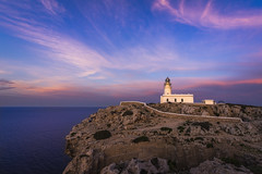 Faro de Cavallera (Miguel A. Garc) Tags: sunset sky espaa lighthouse spain colorful colours menorca baleares balearicislands illesbalears islasbaleares cavalleria nikond600 farodecavalleria nikkor1424