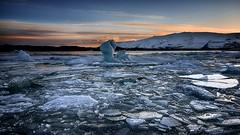 Isolated (Lindi m) Tags: sunset sky frozen iceland lagoon iceberg crackedice jokurlsarlon