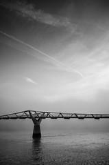 Fog Over The Millennium Bridge, London (Lenscap67) Tags: uk bridge blackandwhite london monochrome weather fog thames river mono fuji britain foggy millennium finepix x100 adverse