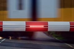 Closed (leunkstar) Tags: red blur bar train lights nikon closed dof ns blurred infrastructure rails crossroads infra spoor intercity bunnik spoorweg d90 spoorwegovergang nikond90 n411