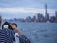NYC skyline from a boat (aleksandr.kalininskiy) Tags: newyorkcity sunset ny newyork tower water skyline skyscraper boat us unitedstates worldtradecenter olympus wtc 124028 epl6