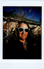 green shirt/green roof (EllenJo) Tags: house selfportrait home yard greenroof 2016 lomographic apricottree fujiinstax linstant february25 fujiinstantfilm ellenjo lomographicsocietyinternational ellenjoroberts
