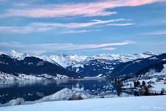 Twilight in the mountains (PaulGsell) Tags: schnee winter sky lake snow mountains cold water clouds reflections landscape schweiz switzerland see twilight wasser dusk himmel wolken berge landschaft klte abenddmmerung spiegelungen sihlsee