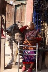 Patan, Nepal (Sharon and Peter Komidar) Tags: nepal candid lion resting patan peoplewatching walkingframe