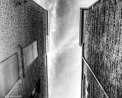 The Sky In Between (that_damn_duck) Tags: southcarolina unitedstates buildings alleyway alley bw blackwhite nikon