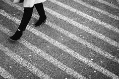 Crosswalk (matt.hagge) Tags: street city light urban blackandwhite white canada abstract streets texture monochrome lines vancouver walking concrete daylight shoes day bc legs outdoor ambientlight walk streetphotography naturallight diagonal fujifilm minimalism fujinon f12 56mm xt1 fujinonxf56mmf12