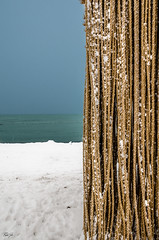 Floating Ropes - Detail (rakelgoiri) Tags: blue winter orange brown white lake snow toronto ontario cold detail texture water outdoor squares serene snowing ropes lakeontario minimalist tranquil torontobeaches freezethaw nikond7000 hangingropes winter2016 torontowinterstations2016 rakelgoiri