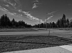 Corner (cj howitt) Tags: street ontario clouds corner blackwhite kingston industrialpark