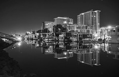 Quiet San Francisco night (PeterThoeny) Tags: sanfrancisco california city longexposure blackandwhite reflection water monochrome skyline architecture night creek river gold lights golden boat waterfront outdoor houseboat clear highrise hdr missionbay waterreflection photomatix fav200 1xp nex6 selp1650