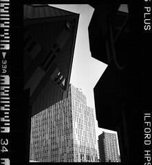 Cube Houses (RafaelGonzalez.) Tags: leica travel blackandwhite film architecture 35mm buildings rotterdam europe cityscape thenetherlands analogue leicam6 ilfordhp5plus cubehouses rafaelgonzalez