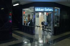 Clip Joint (MPnormaleye) Tags: city nyc urban window glass sign shop night neon moody chairs manhattan arcade barber utata salon 24mm linoleum