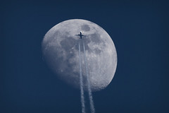 Moon and plane (deanhammersley) Tags: moon plane flying flight jet pass across lunar 737 moonandplane aircraftandmoon