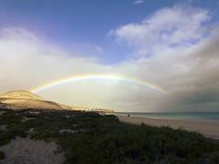 Rainbow In The Sky (John LaMotte) Tags: arcoiris clouds rainbow fuerteventura playa cielo nubes arcoris islascanarias nwn infinitexposure