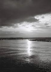 Light waters I (bigalid) Tags: light sunset bw kodak harbour northumbria april kodakbw400cn amble 2016 bw400cn c41 olympuspenee2