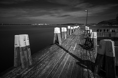 Marina Walkway, Gteborg, 2014 (Mabry Campbell) Tags: longexposure blackandwhite seascape water june marina gteborg photography coast harbor pier photo europe foto photographer image sweden fineart gothenburg may nopeople coastal photograph 100 pilings 40mm bild scandinavia f28 2012 fineartphotography 2014 architecturalphotography leadinglines vstragtaland commercialphotography architecturephotography fineartphotographer houstonphotographer sec mabrycampbell ef40mmf28stm june272012 201206271833