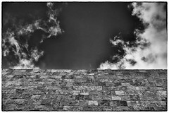 Cloudy Wall (Rolf Siggaard) Tags: sky bw building monochrome museum architecture clouds blackwhite losangeles shapes structure symmetry manmade gettycentre mirrorless fujix100s x100s 23mmapsc