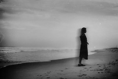Let our shadows wither (.everlasting) Tags: sea film water girl 35mm blackwhite haze shadows wither shore analogue melancholy mystic blackness everlasting feverdreams hadararielmagar