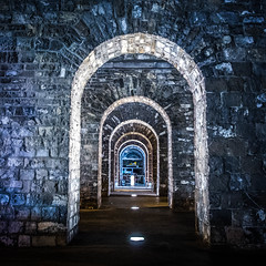 Take off (yann.zitouni) Tags: old city bridge light urban night stones tunnel arches historical converginglines